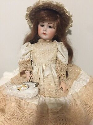 Vintage Reproduction Bisque Doll.