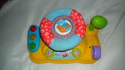 3 colourful baby toys inc. Vtech Baby Driver,  musical dog + suction octopus
