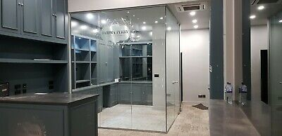 Two Sides Of Soundproof Glass Partition With A Glass Door & Frames
