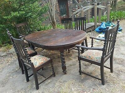 1920s OAK JACOBEAN STYLE EXTENSION DINING TABLE AND 8 CHAIRS