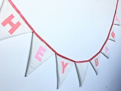 baby shower bunting with pink letters, on triangle flags, with satin ribbon,