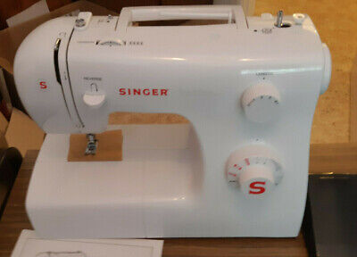 singer sewing machine 2250. Bought new, never used. Comes with small table.