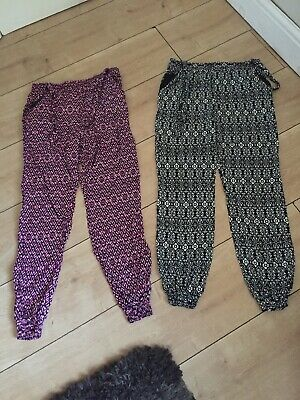 2 Pairs Of Girls Trousers Aged 9-10