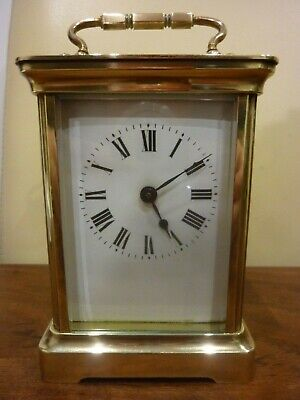 An Antique Brass Carriage Clock stamped LION Eight  DAY CLOCK with KEY