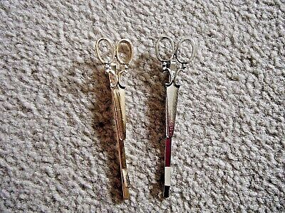 New set of 2 scissor hair clips, one gold coloured, one silver
