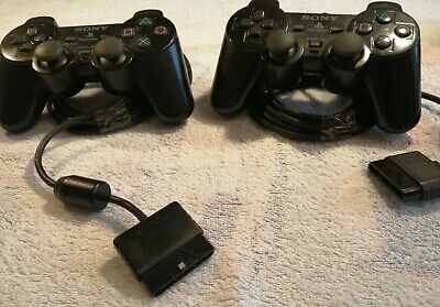 2 Official Sony Playstation 2 PS2 Dual Shock 2 Black Wired Controllers used.