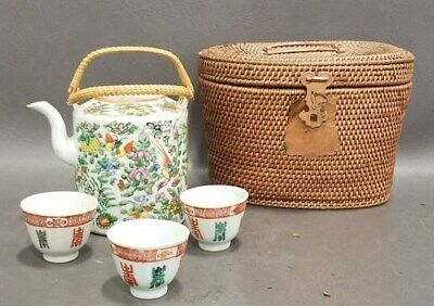 Antique Chinese Teapot with Basket and Cups