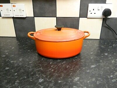 le creuset cast iron  casserole dish and lid  in orange finish