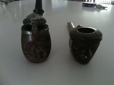 old hand carved pipes one new one used one is timber