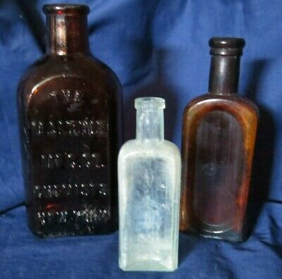 Three Vintage Glass Medicine Bottles