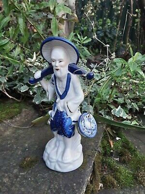 Vintage blue & white ceramic Oriental Fisherman figurine