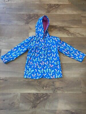Lovely HATLEY Girls Rain Coat Blue With Butterflies And Pockets Age 7 years