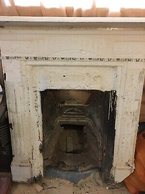 Two Antique cast iron fireplace surrounds