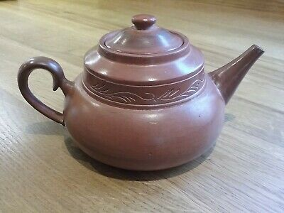 Chinese, or Chinese style, red clay teapot, decorated band, strainer intact.