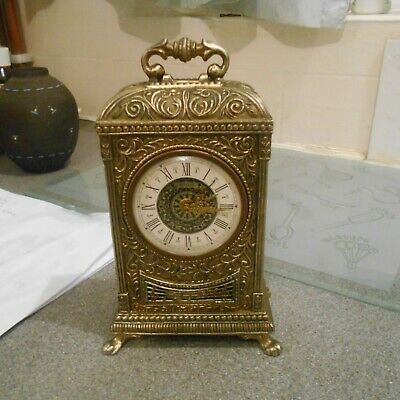 "estyma, metal, musical alarm clock, 7"" high, couple of replacement bits at back"