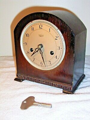 SMITHS MANTLEPIECE CLOCK, 8 DAY. Working requires attention, missing glass door.