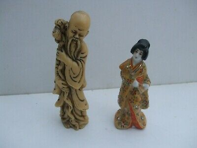 a pair of oriental figures resin chinese monk and a japanese geisher