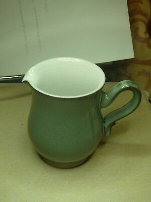 Denby Venice milk jug in Craftsman style, green with white patterned foot