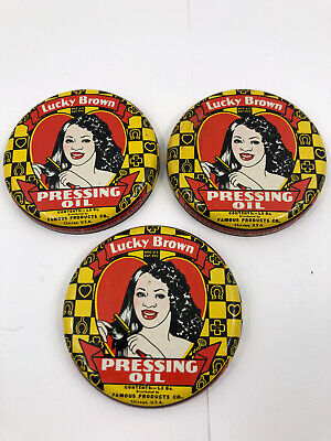 Vintage Lucky Brown Pressing Oil Tin Lids Famous Product Chicago Black Americana