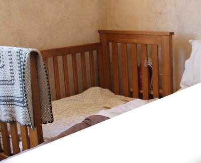 Beautiful timber babies cot with removeable sides