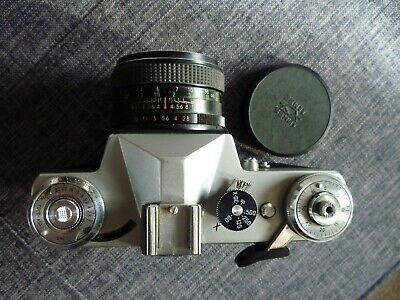 Zenit E 35mm SLR with 50mm lens and case. Camera tested, fully working. Read: