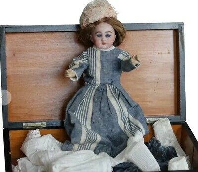 An antqiue  Globe Baby doll by Carl Hartmann with an antique trunk