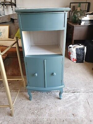 antique vintage hall cupboard or washstand with a bow front and flip top storage