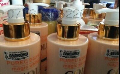 New PURE EGYPTIAN GOLD MAGIC WHITENING BODY AND FACE LOTION (Stained)