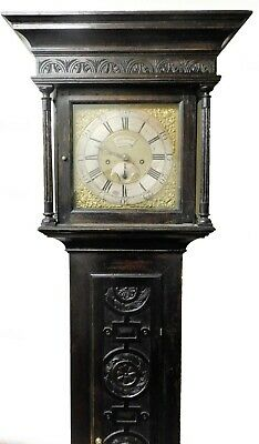 18THC OAK LONGCASE CLOCK, SQUARE HOOD CARVED FRONT PANEL by JL Kemp of Broadway.