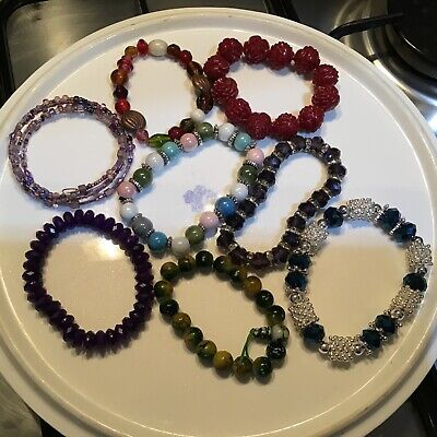 Selection of beaded glass plastic bracelets Multicoloured arts crafts