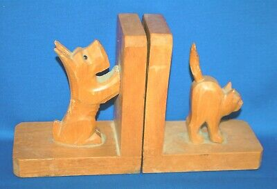 A pair of carved dog and cat bookends, antique,wooden, as found