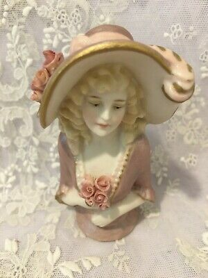 "Reproduction half doll ""Lady Jayne"" is  9.5 tall painted  pale mulberry."