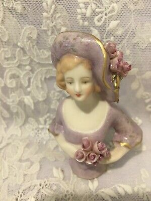 "Reproduction half doll ""Angnita"" painted in mauve with decal and trimmed in gold"