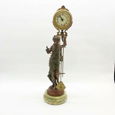 French Canister Style Mystery Swinger clock Diana statue, rear wind