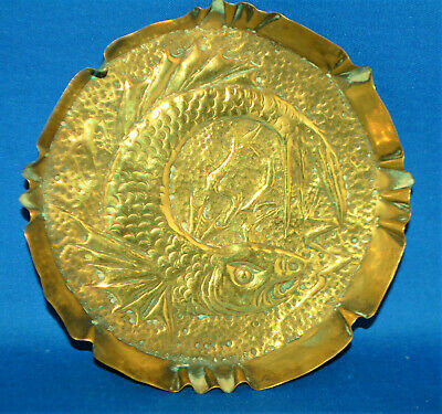 An antique Arts and Crafts sea serpent, fish repousse brass pressed dish, plate