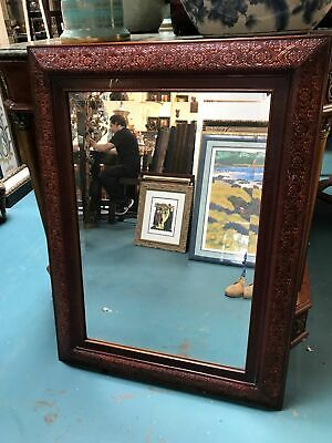 Beveled Glass Mirror In Detailed Wooden Frame