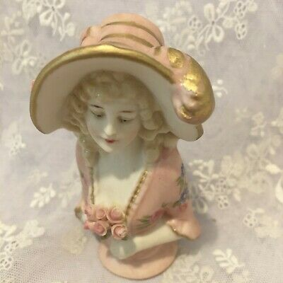 "Reproduction half doll ""Lady Jayne"" is  9.5 tall painted  pale pink with decals"