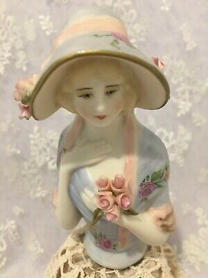"Reproduction half doll ""Verity"" is  9.5 tall painted pink & blue with decals"