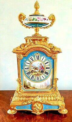 A French Porcelain Mounted Ormolu Mantel Clock