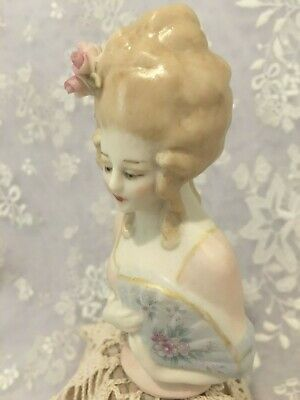 "Porcelain Half Doll ""Janti"" appox 9 cms tall painted in chiffon blue & pale pink"