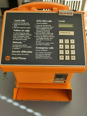 Telecom Gold Pay Phone with original wall mount stand - Collectible Item