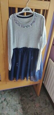 Girls grey and navy dress with sequins for 9 years. Dress never worn.