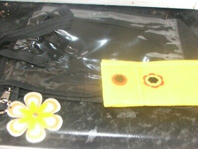 1 black and clear make up bag with yellow glasses case plus flower key ring