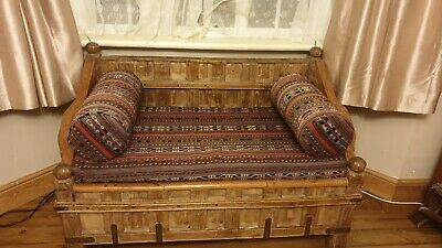 hardwood Indian settle with storage, in good condition.with cushions