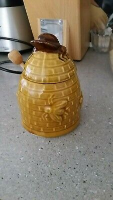 Vintage Bee Hive Honey Pot with Dipper and Bee on top.