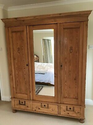 Solid antique pine triple wardrobe with hanging rail, drawers and shelves