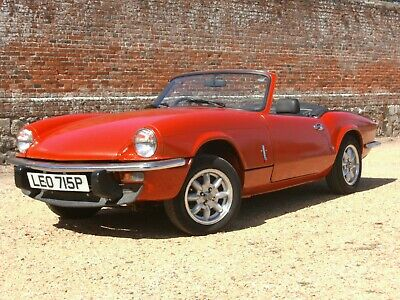 Triumph Spitfire - early 1500 finished in Pimento red, mini lite alloys