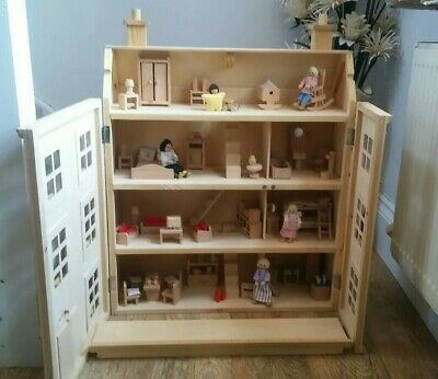 * Classic four storey wooden dolls house with all furniture with people *(3)