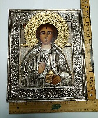 Antique quality Russian Orthodox Icon of St. Panteleimon with silver riza