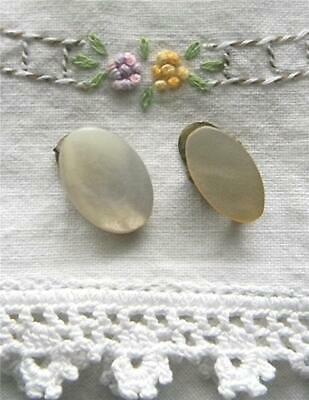 TWO OVAL ANTIQUE VICTORIAN MOTHER OF PEARL & BRASS NAPKIN CLIPS (not matching)